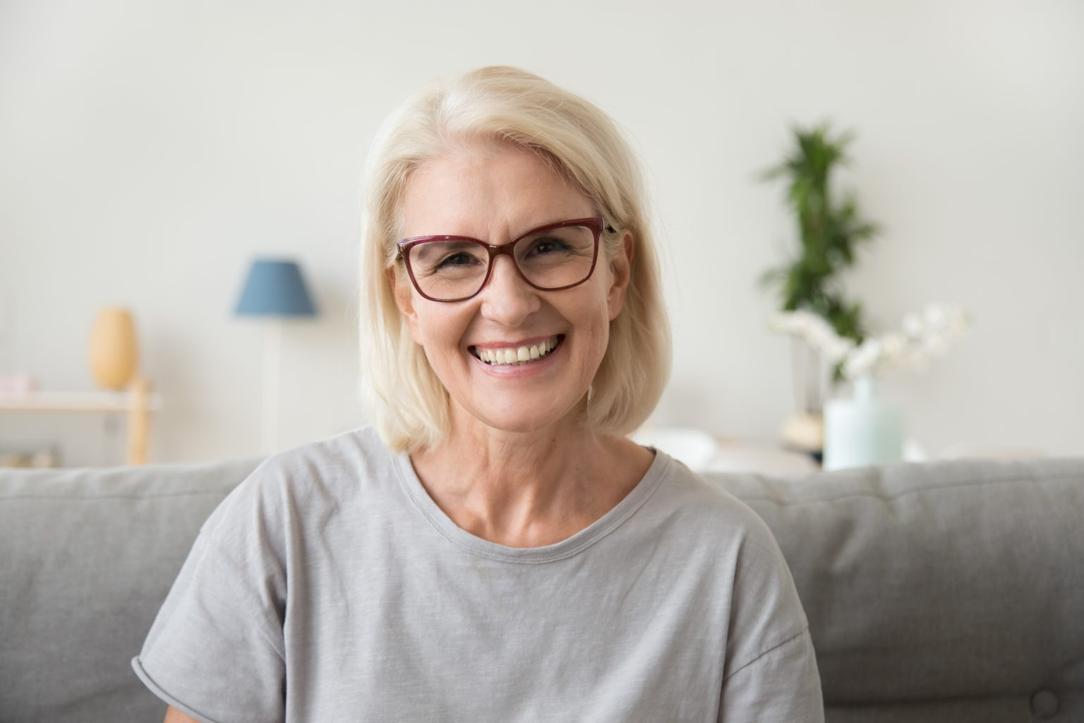 Smiling Middle Aged Mature Grey Haired Woman Looking At Camera